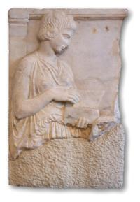 Relief of a person examining a wax tablet